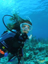 underwater modeling for her dad in Key Largo